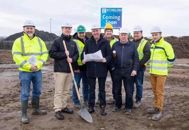 Echelon Data Centres COO Graeme McWilliams (second left) and CEO Niall Molloy (fourth from left) with members of the construction team at the company's Clondalkin site