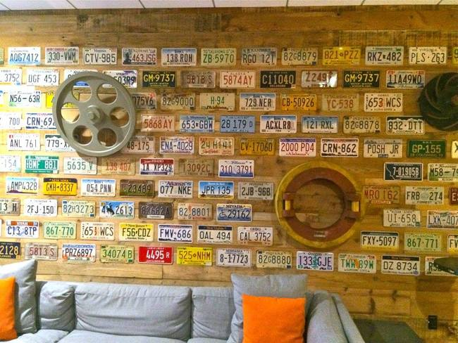 The license plate wall at the Altoona Data Center was created with plates and pieces from West End Architectural Salvage & Coffee Shop in Des Moines