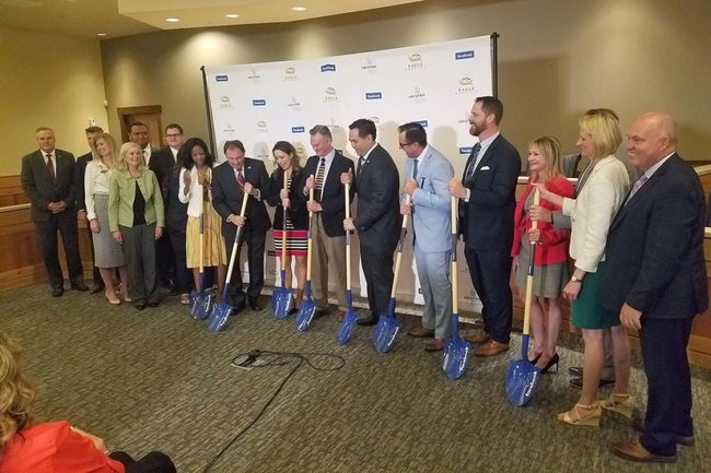 Government officials and representatives of Facebook pose with shovels following the announcement that Facebook will build a data center in Eagle Mountain, Utah.  May 2018.