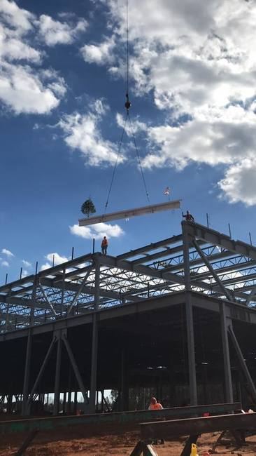 "The practice of ""topping out"" a new building can be traced to the ancient Scandinavian religious rite of placing a tree atop a new building to appease the tree-dwelling spirits displaced in its con..."