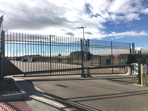 With over 2000 feet of high security perimeter fence, two vertical pivot gates, several security barrier arms and a large 30 foot automated cantilever gate