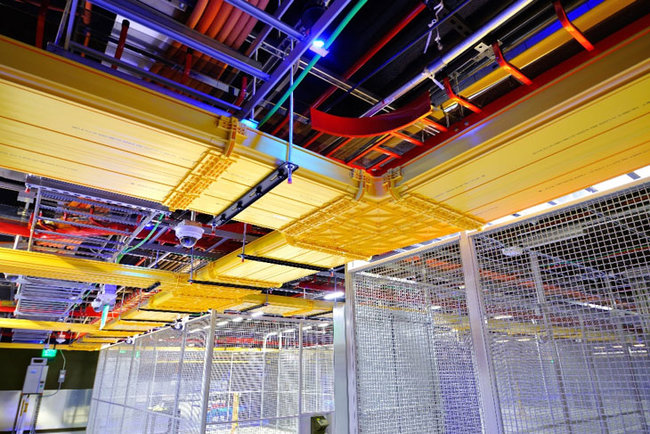 Note the width of the yellow fiber trays. There must be alot of cross connects in the facility!
