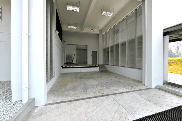 The loading bay consists of a one meter height platform for two trucks for loading/unloading of heavy equipment. The roller shutter is integrated with interlocking control design to prevent unautho...