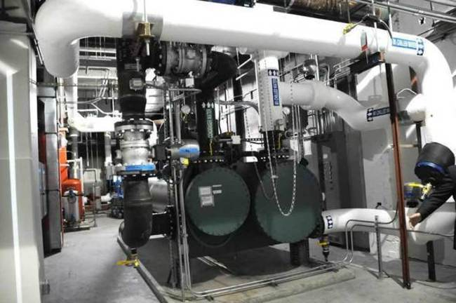 The chiller plant on the 4th floor of the data center is comprised of condenser water pumps and risers that are responsible for maintaining the appropriate temperature in the data center. The ceili...