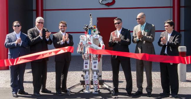 Left to right: Senator Michael Roberson, Commissioner Steve Sisolak, Switch Founder and CEO Rob Roy, UNLV's Metal Rebel Robot, Governor Brian Sandoval, Senator Aaron Ford and Dr. Paul Oh celebrate ...