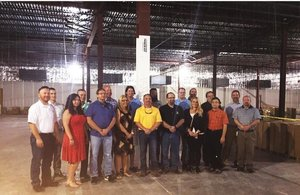 OKC data center celebration as employees & workers held a topping out ceremony. Each signed a pillar.