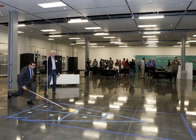 Attendees play shuffleboard during the grand opening party for the V6 building on the Vantage Santa Clara Campus